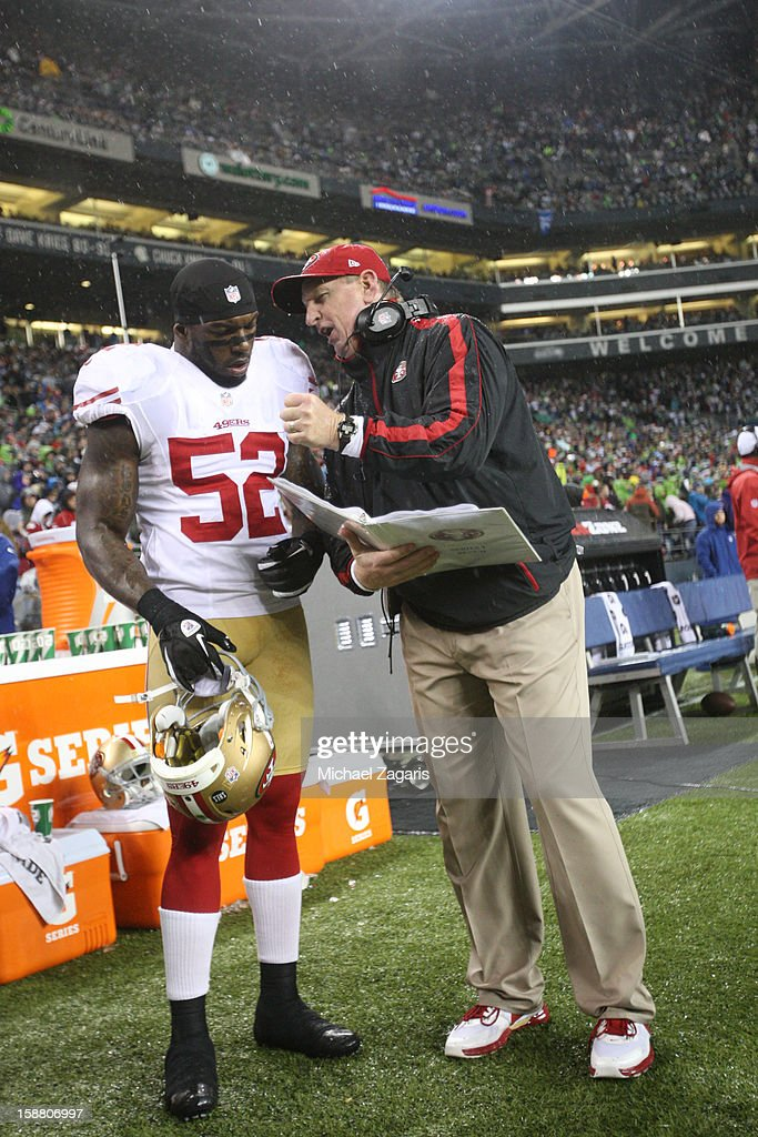 Linebackers Coach Jim Leavitt of the San Francisco 49ers talks with Patrick Willis during the game against the Seattle Seahawks at CenturyLink Field...