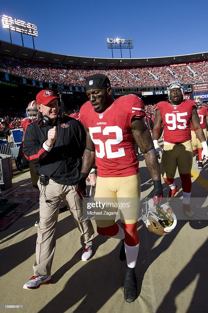 Linebackers Coach Jim Leavitt of the San Francisco 49ers talks with Patrick Willis #52 during the game against the Arizona Cardinals at Candlestick Park on December 30, 2012 in San Francisco, California. The 49ers defeated the Cardinals 27-13.