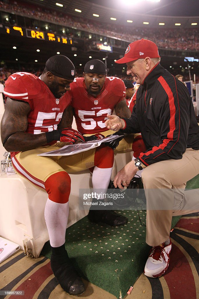 Linebackers Coach Jim Leavitt of the San Francisco 49ers talks with Patrick Willis and NaVorro Bowman during the game against the Green Bay Packers...