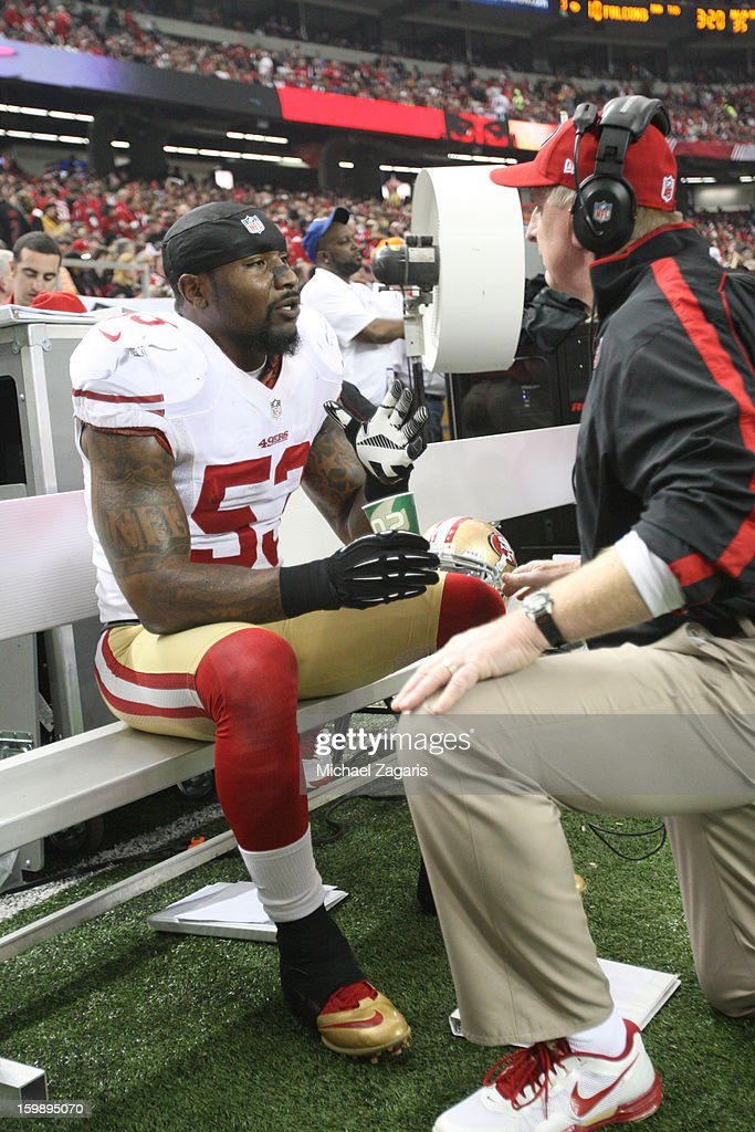 Linebackers Coach Jim Leavitt of the San Francisco 49ers talks with NaVorro Bowman during the game against Atlanta Falcons in the NFC Championship...