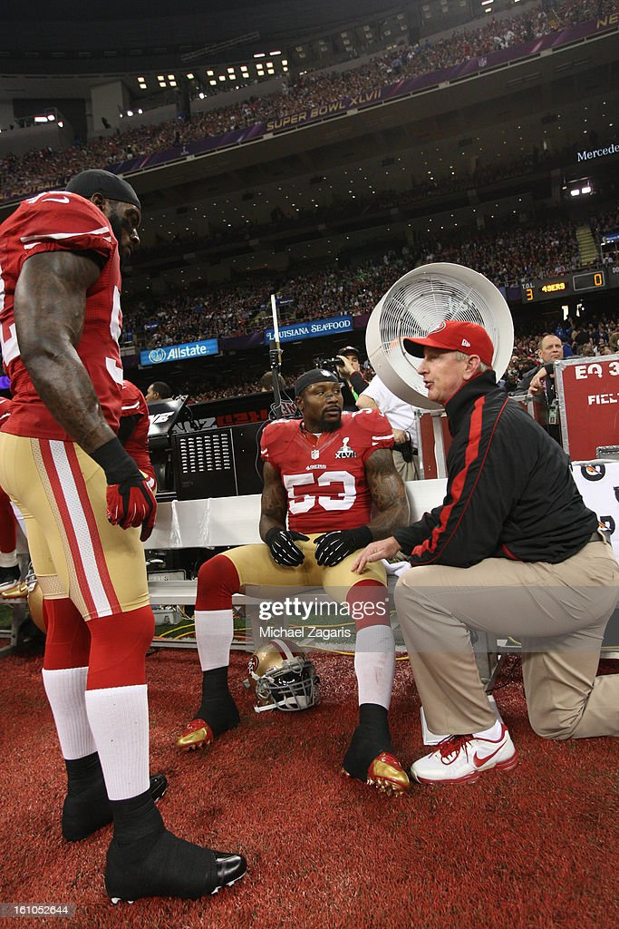 Linebackers Coach Jim Leavitt of the San Francisco 49ers talks with Patrick Willis and NaVorro Bowman during Super Bowl XLVII against the Baltimore...