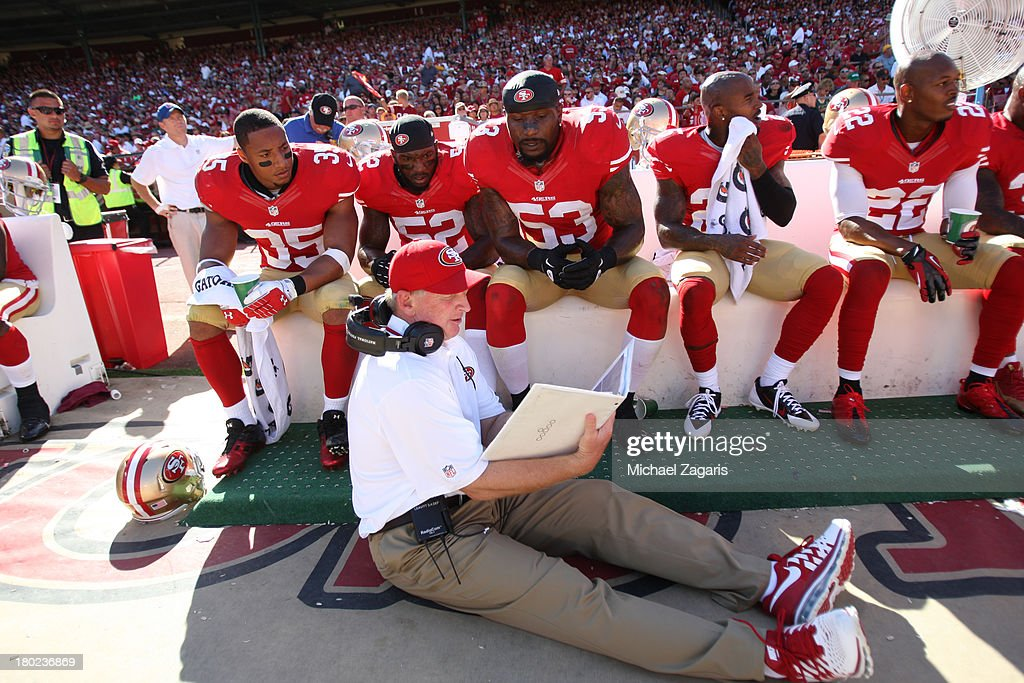 Linebackers Coach Jim Leavitt of the San Francisco 49ers talks with Eric Reid Patrick Willis and NaVorro Bowman during the game against the Green Bay...