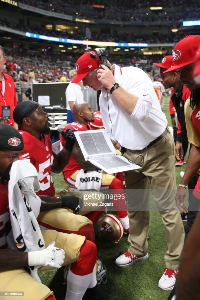 Linebackers Coach Jim Leavitt of the San Francisco 49ers talks with NaVorro Bowman during the game against the St Louis Rams at the Edward Jones Dome...