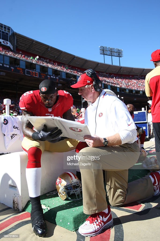 Linebackers Coach Jim Leavitt of the San Francisco 49ers talks with Patrick Willis during the game against the Arizona Cardinals at Candlestick Park...