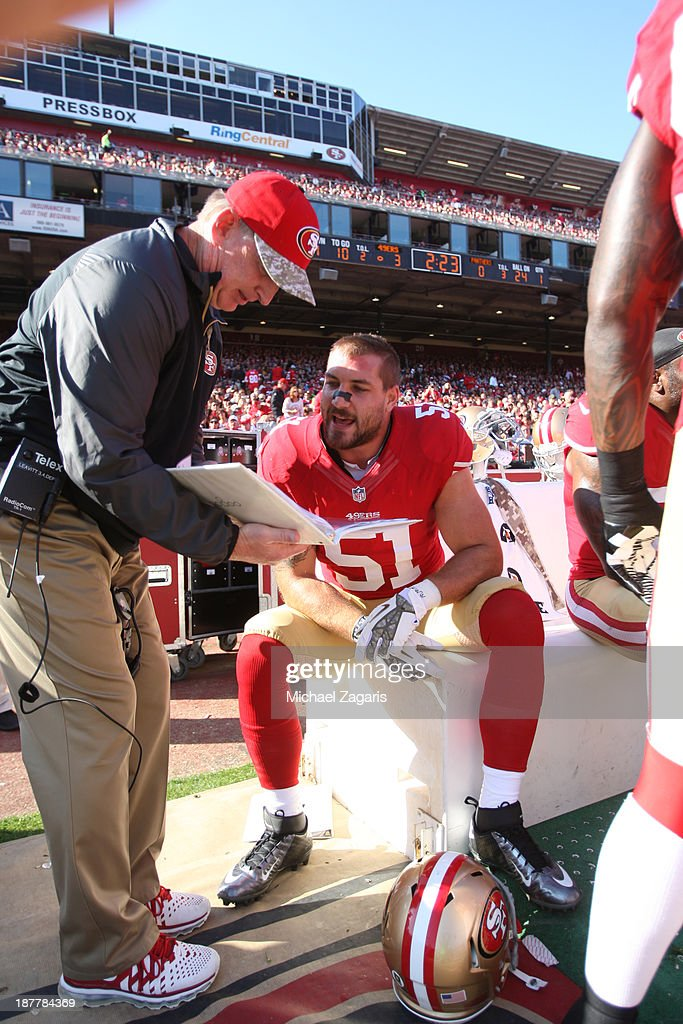 Linebackers Coach Jim Leavitt of the San Francisco 49ers talks with Dan Skuta during the game against the Carolina Panthers at Candlestick Park on...