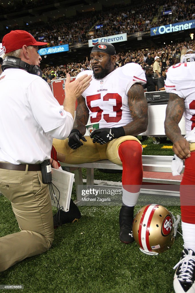Linebackers Coach Jim Leavitt of the San Francisco 49ers talks with NaVorro Bowman during the game against the New Orleans Saints at the Superdome on...