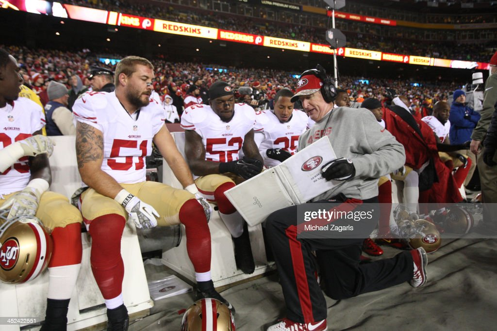 Linebackers Coach Jim Leavitt of the San Francisco 49ers talks with Dan Skuta and Patrick Willis during the game against the Washington Redskins at...