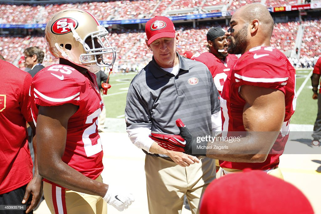Linebackers Coach Jim Leavitt of the San Francisco 49ers talks with Jimmie Ward and Michael Wilhoite during the game against the Denver Broncos at...