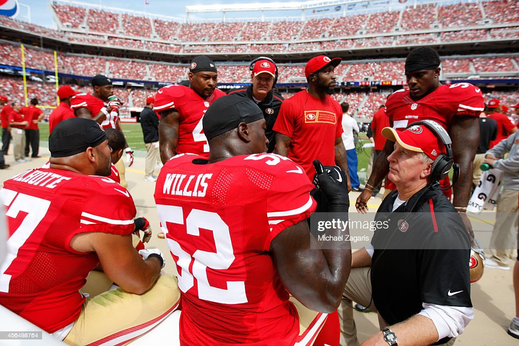 Linebackers Coach Jim Leavitt of the San Francisco 49ers talks with Patrick Willis during the game against the Philadelphia Eagles at Levi Stadium on...