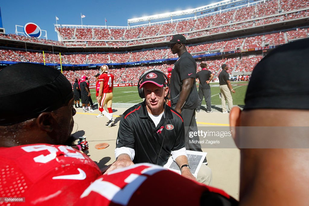 Linebackers Coach Jim Leavitt of the San Francisco 49ers talks with Patrick Willis during the game against the Kansas City Chiefs at Levi Stadium on...
