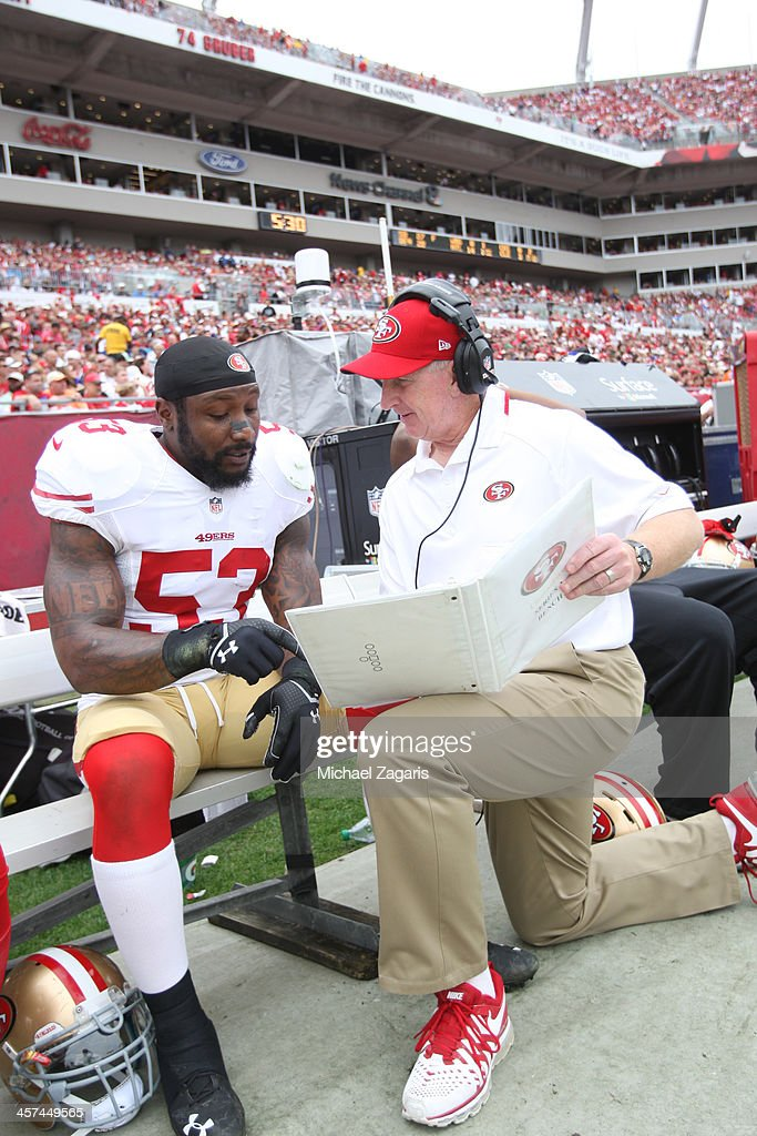 Linebackers Coach Jim Leavitt of the San Francisco 49ers talks with NaVorro Bowman during the game against the Tampa Bay Buccaneers at Raymond James...