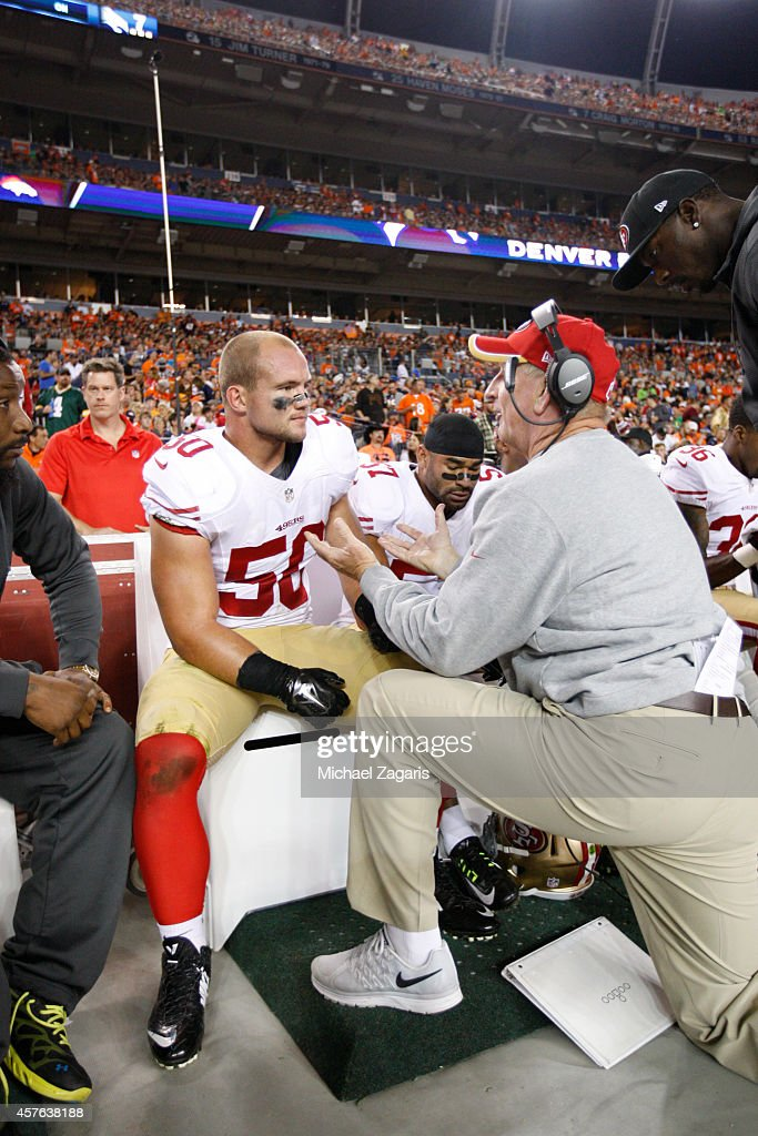 Linebackers Coach Jim Leavitt of the San Francisco 49ers talks with Chris Borland during the game against the Denver Broncos at Sports Authority...
