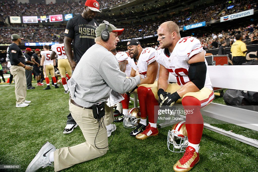 Linebackers Coach Jim Leavitt of the San Francisco 49ers talks with Chris Borland during the game against the New Orleans Saints at the MercedesBenz...