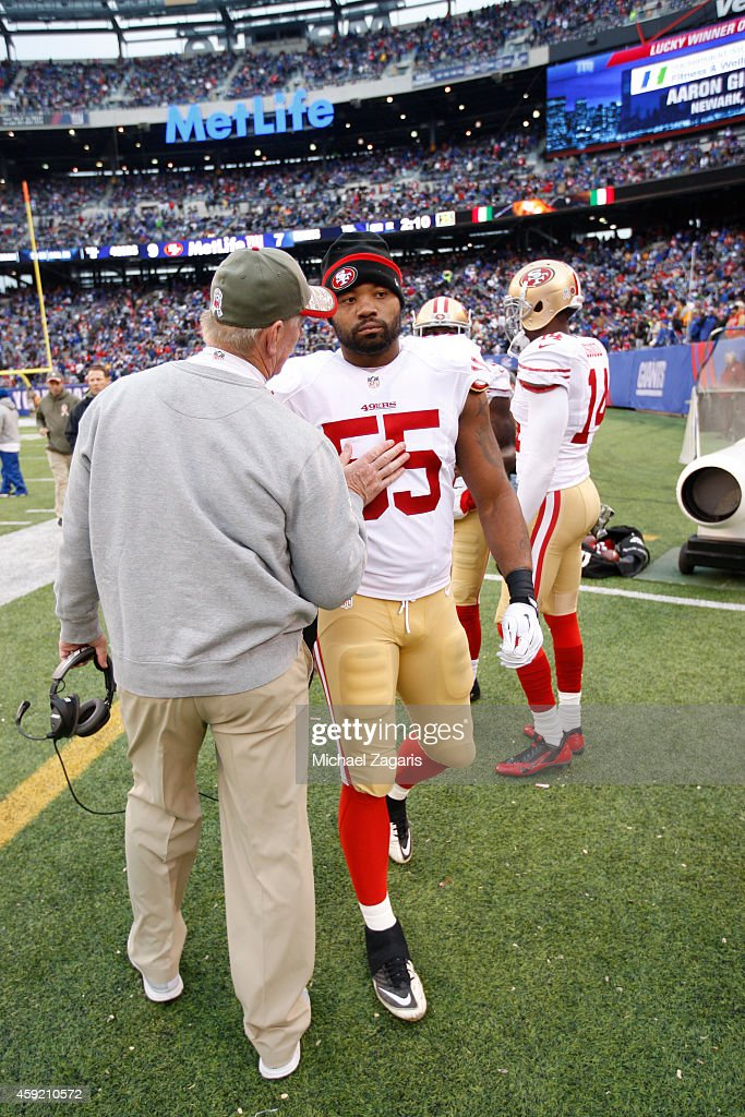 Linebackers Coach Jim Leavitt of the San Francisco 49ers talks with Ahmad Brooks during the game against the New York Giants at Metlife Stadium on...