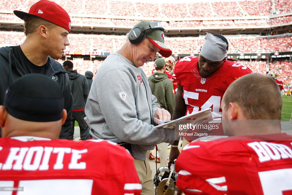 Linebackers Coach Jim Leavitt of the San Francisco 49ers talks with Nick Moody during the game against the Washington Redskins at Levi Stadium on...