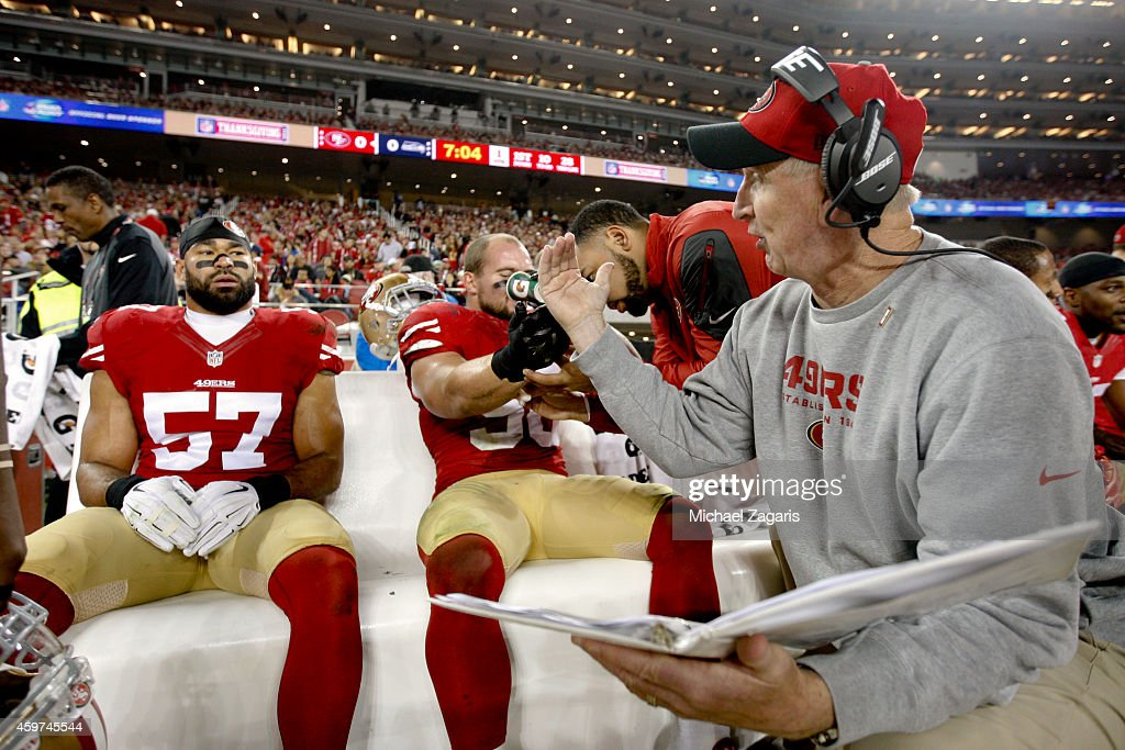 Linebackers Coach Jim Leavitt of the San Francisco 49ers talks with Michael Wilhoite during the game against the Seattle Seahawks at Levi Stadium on...