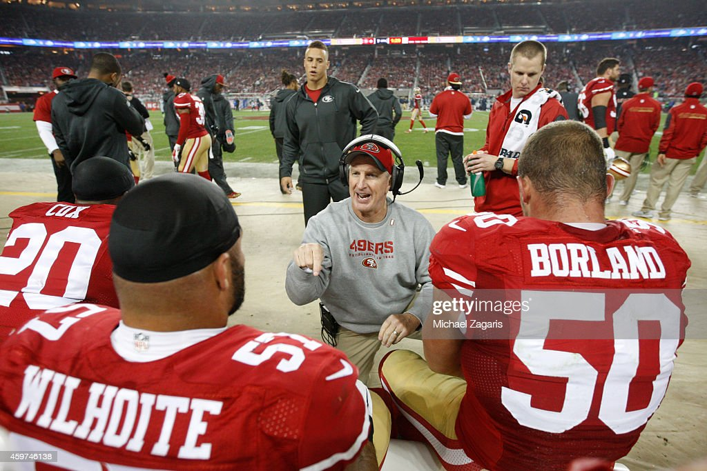 Linebackers Coach Jim Leavitt of the San Francisco 49ers talks with Michael Wilhoite and Chris Borland during the game against the Seattle Seahawks...