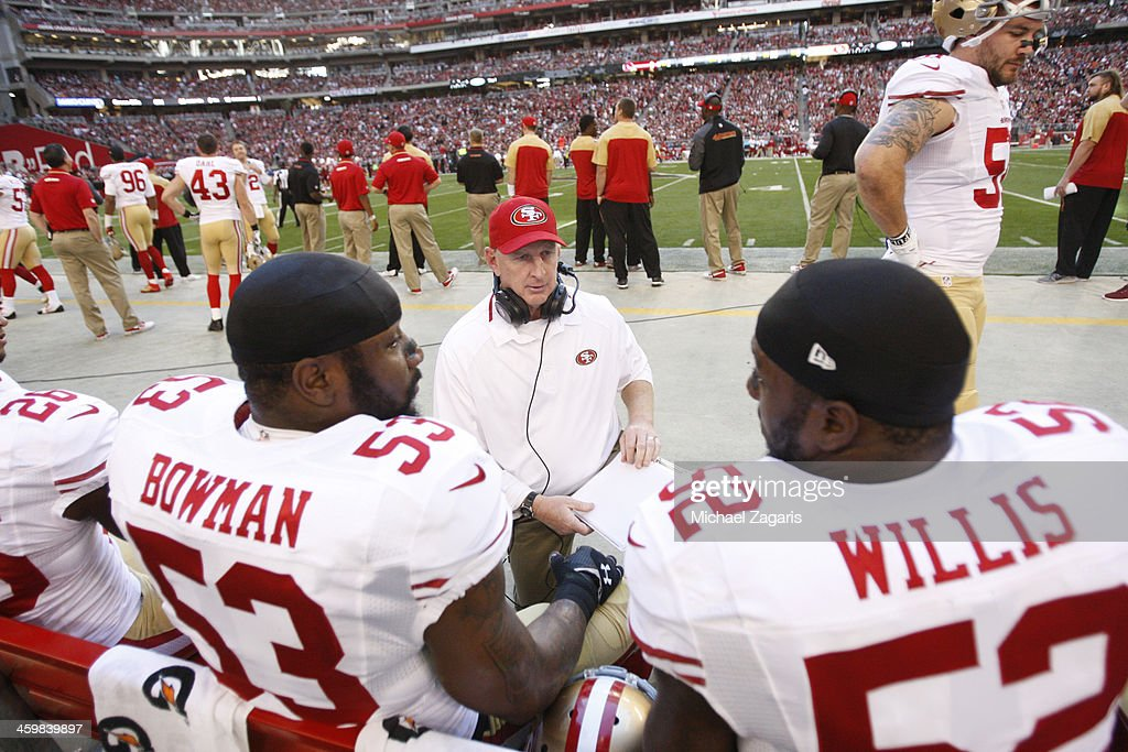 Linebackers Coach Jim Leavitt of the San Francisco 49ers talks with NaVorro Bowman and Patrick Willis during the game against the Arizona Cardinals...