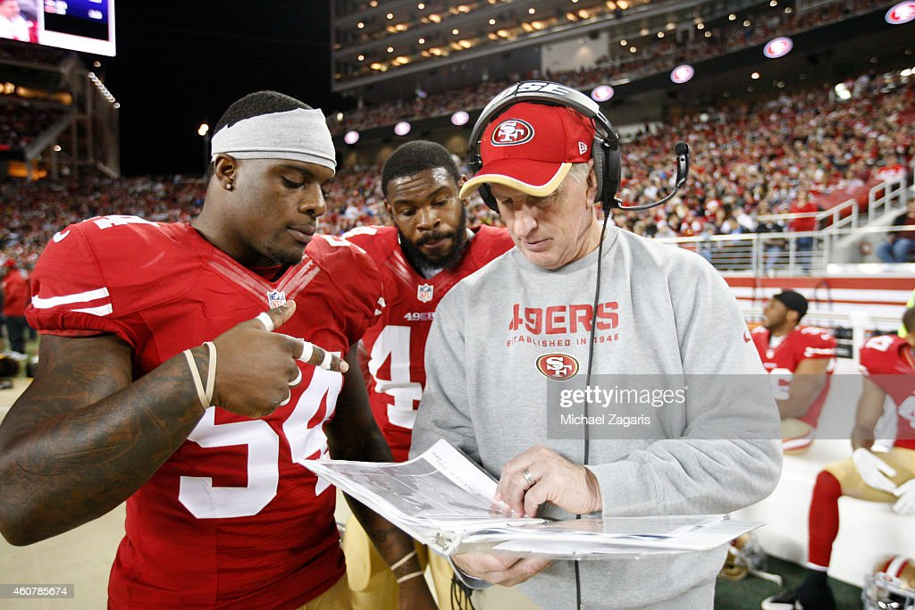 Linebackers Coach Jim Leavitt of the San Francisco 49ers talks with Nick Moody and Desmond Bishop during the game against the San Diego Chargers at...