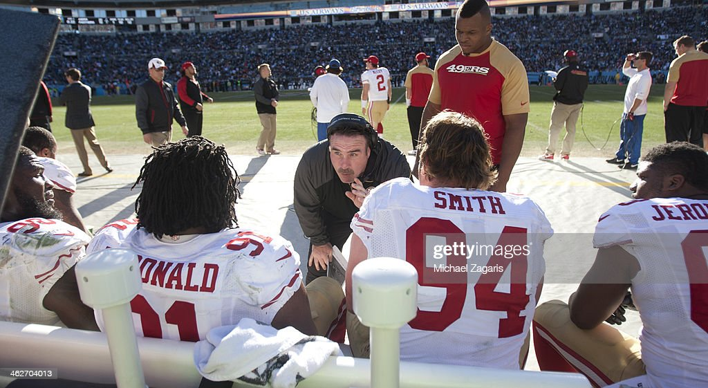 Linebackers Coach Jim Leavitt of the San Francisco 49ers talks with the offensive line during the game against the Carolina Panthers at Bank of...