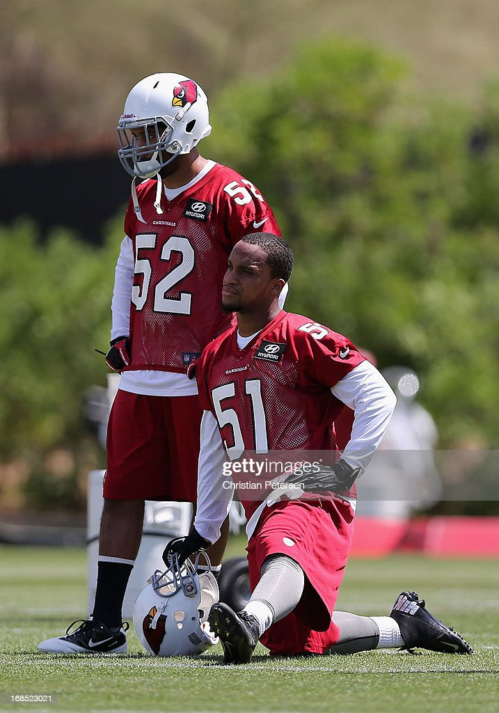 Linebackers Colin Parker #52 and Kevin Minter #51 of the Arizona Cardinals practice at the team's training center facility on May 10, 2013 in Tempe, Arizona.