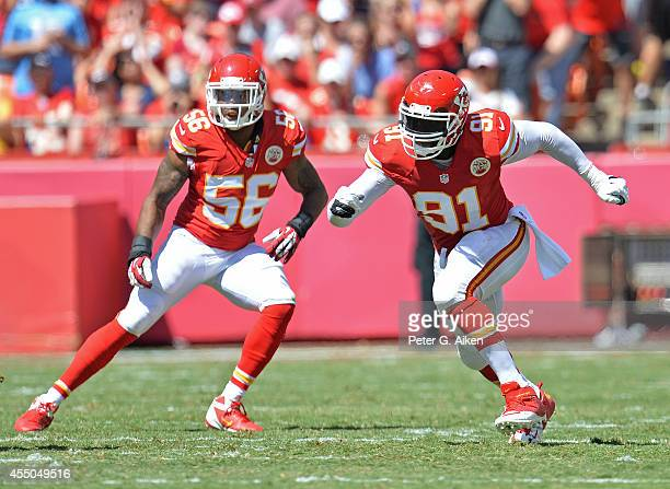 Linebackers Tamba Hali and Derrick Johnson of the Kansas City Chiefs get set on defense against the Tennessee Titans during the first half on...