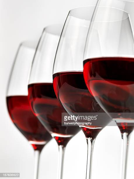 Lined up row of glasses of red wine