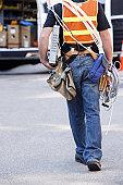 Lineman carrying a modem