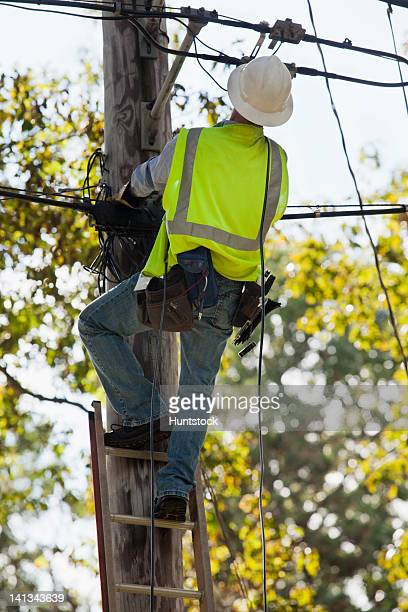 Lineman getting ready to install cable connection to a home