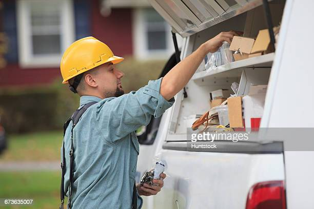 Lineman pulling supplies out of his truck for installation