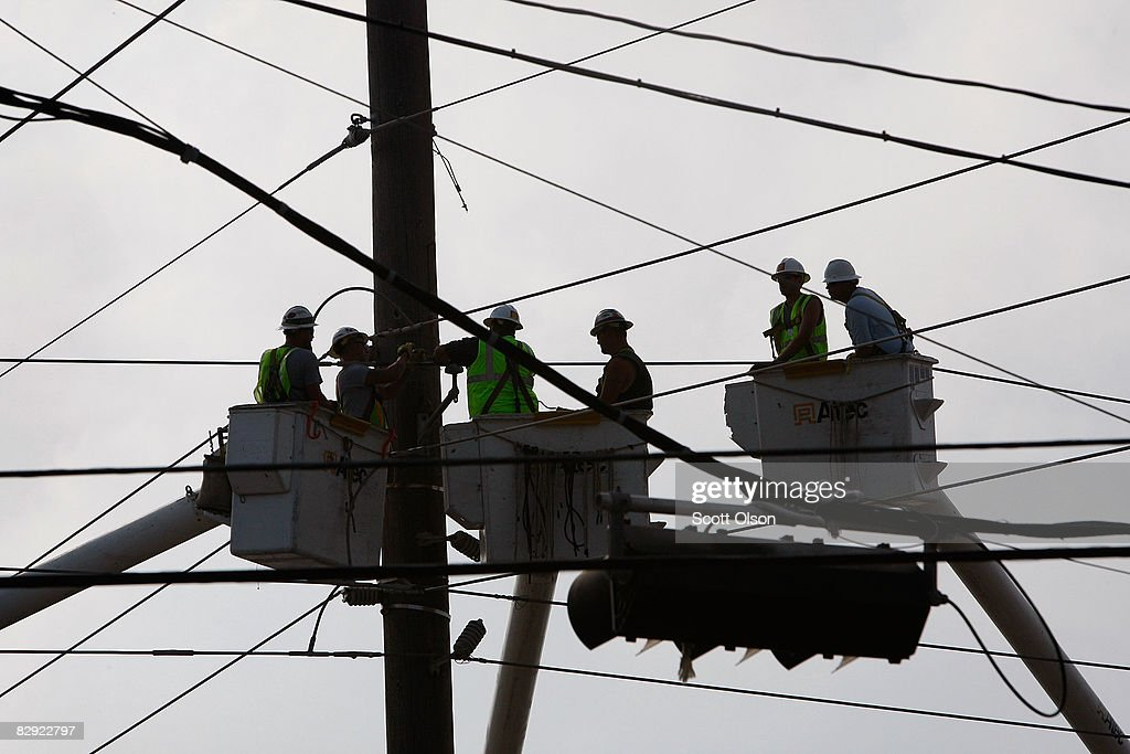 Linemen work to restore power knocked out by Hurricane Ike September 19 2008 in Galveston Texas Most of Galveston Island remains without power water...