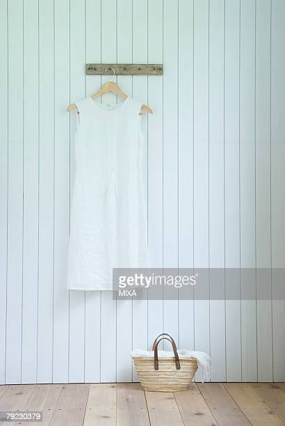 Linen dress hanging on wall