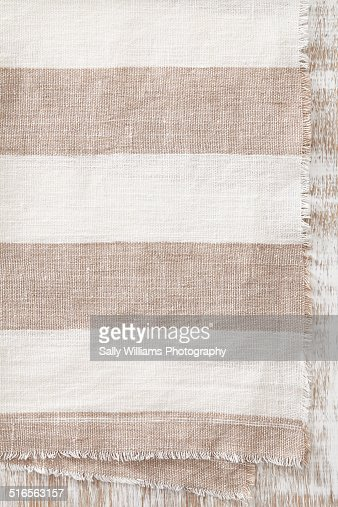 A linen napkin on a whitewashed oak background