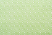 Linen napkin with a clear geometric pattern. Diamonds and squares. Background pattern.