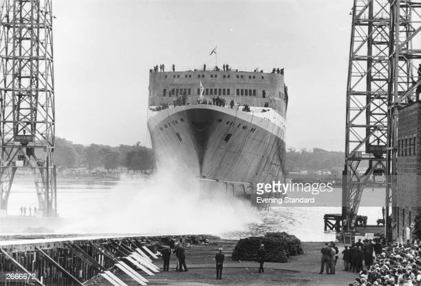 Liner QE2 taking to the water at Clydebank after being named by Queen Elizabeth II