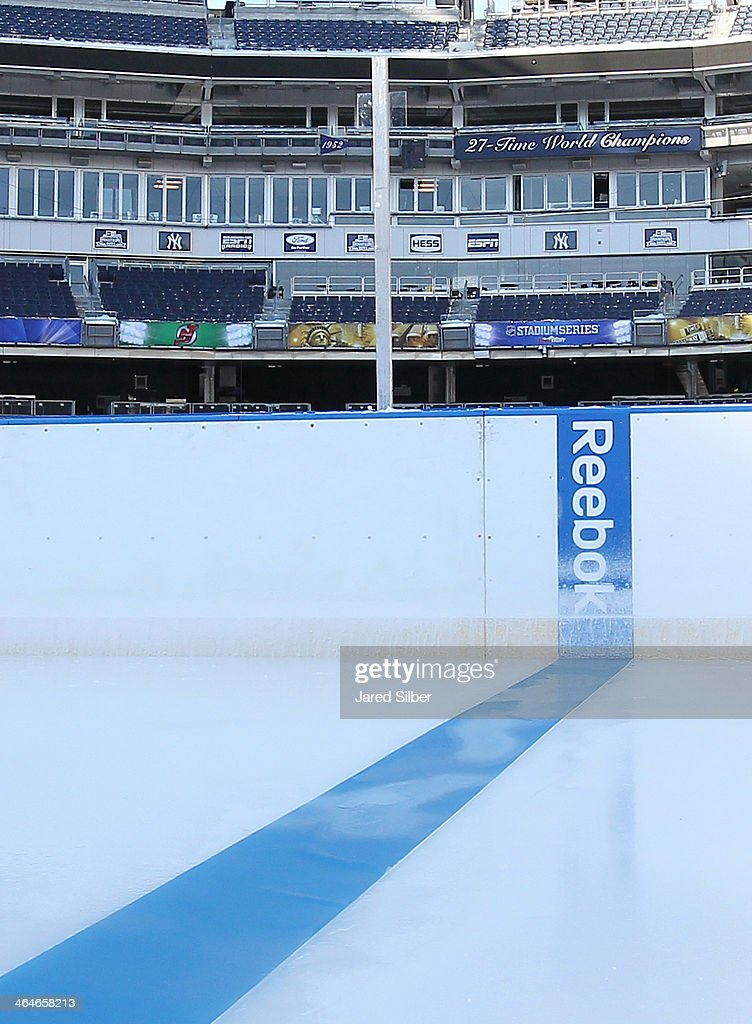 Lines and logos are added during the rink build for the 2014 Coors Light Stadium Series Games at Yankee Stadium on January 23, 2014 in the Bronx borough of New York City. The games are scheduled to be played on Sunday, January 26, 2014 and Wednesday, January 29, 2014.