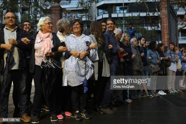 Lines of crowds form outside Escola Industrial of Barcelona school in protest and defence of the polling station from police to be opened for...