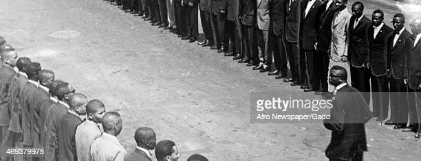 Lines of men standing with Elijah Muhammad leader of the Nation of Islam Baltimore Maryland 1970