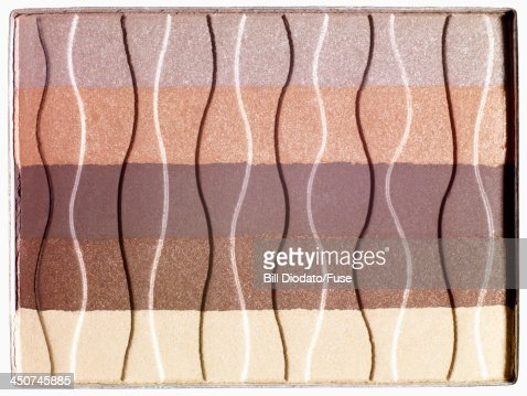 Lines of powdered makeup from single compact : Stock Photo
