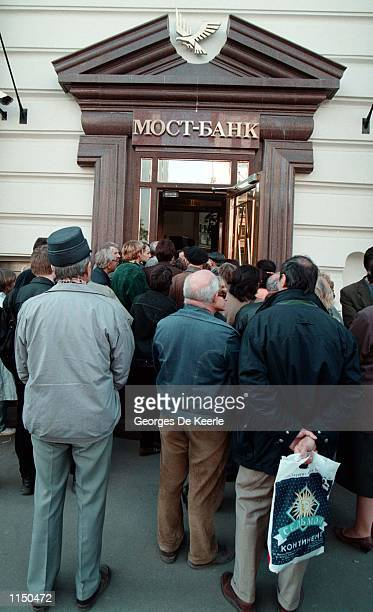 Lines of small depositors form in front of a Russian bank in Moscow September 8 1998 The rouble has slid 60 percent in three weeks Its official rate...