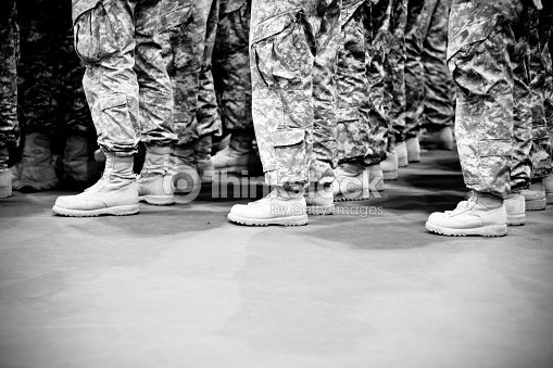 Lines of soldiers standing in formation : Stock Photo