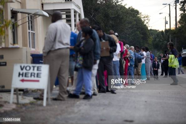Lines of voters wait to cast their ballots as the polls open November 6 2012 in St Petersburg Florida The swing state of Florida is a hotlycontested...