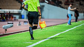 Linesman assistant referee action in the soccer stadium during match
