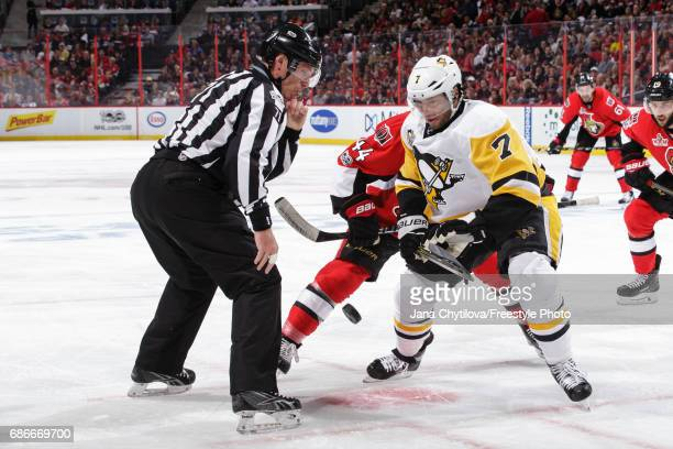 Linesman Brad Kovachik looks on as Matt Cullen of the Pittsburgh Penguins wins a faceoff against JeanGabriel Pageau of the Ottawa Senators in Game...