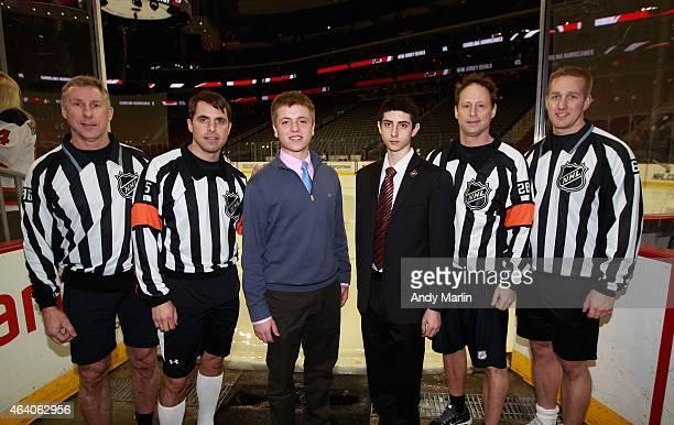 Linesman Brad Lazarowich referee Chris Rooney aspiring official Blake Hishmeh aspiring official Shawn O'Brien referee Chris Lee and linesman Trent...