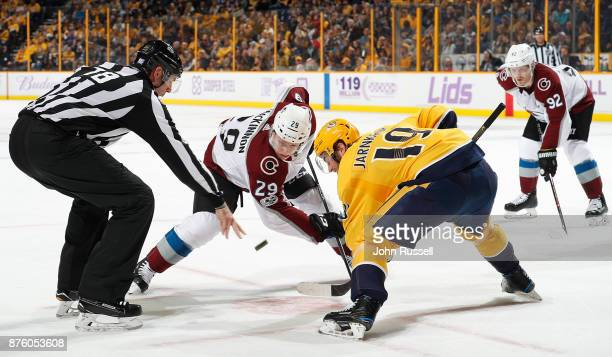 Linesman Brian Mach drops the puck between Nathan MacKinnon of the Colorado Avalanche and Calle Jarnkrok of the Nashville Predators during an NHL...