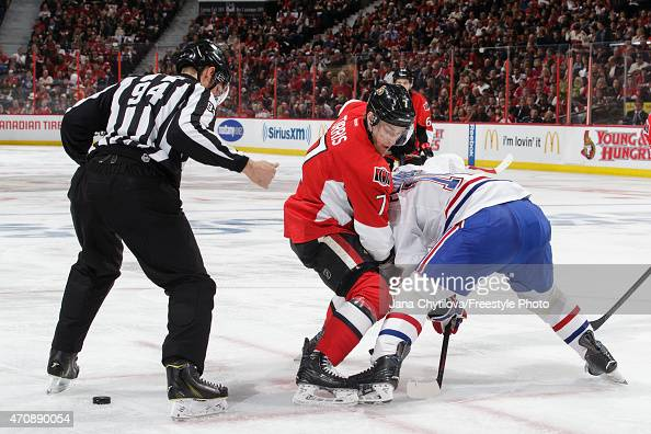 Linesman Bryan Pancich looks on as Kyle Turris of the Montreal Canadiens wins a faceoff against Tomas Plekanec of the Ottawa Senators in Game Four of...