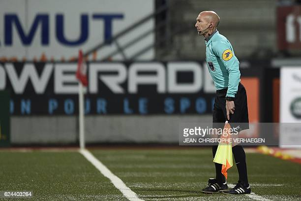 Linesman Cyril SaintCricq Lompre follows the French L1 football match between Nancy and Dijon at the Marcel Picot stadium in Tomblaine eastern France...