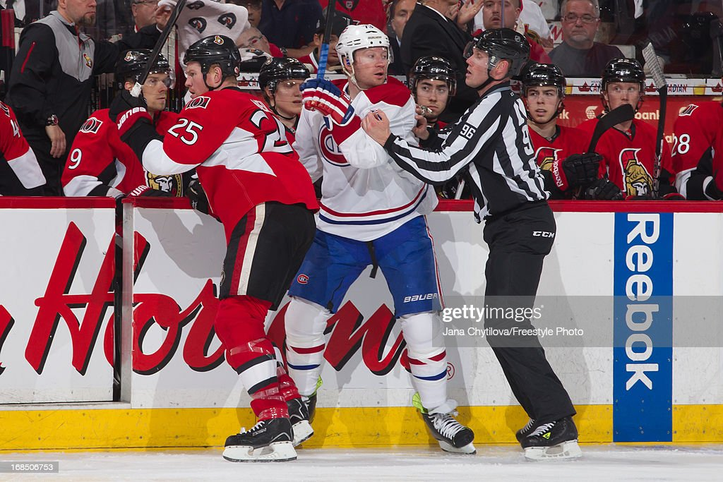 Linesman David Brisebois #96 grabs Michael Ryder #73 of the Montreal Canadiens after a tussle with Chris Neil #25 of the Ottawa Senators in Game Four of the Eastern Conference Quarterfinals during the 2013 NHL Stanley Cup Playoffs at Scotiabank Place on May 7, 2013 in Ottawa, Ontario, Canada.