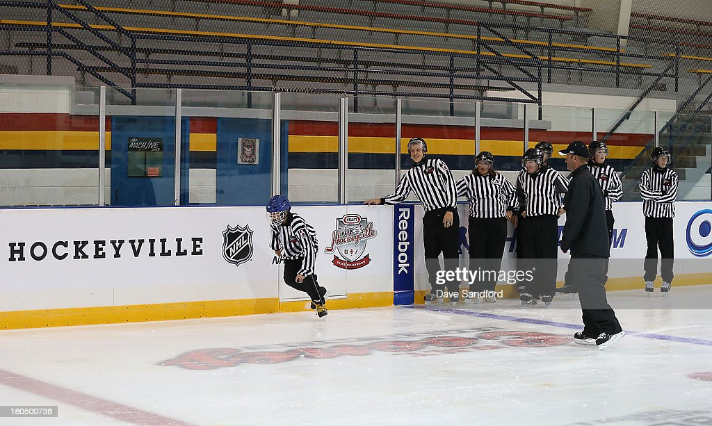 Linesman Derek Nansen looks on as local minor league officials partake in a drill during the NHL Officials Clinic at the Stirling and District Recreation Centre during Kraft Hockeyville Day 1 on September 13, 2013 in Stirling, Ontario, Canada.
